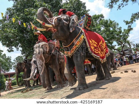 the lunar month of every year, this year falls on May 19, 2016 Ban Ta Klang Elephant Village where The district Krapho Tum Surin Province  Ordination parade on elephant's back
