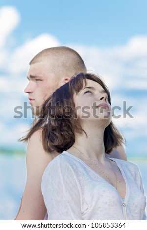 The man and the woman sit against - stock photo