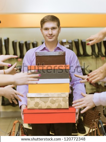The man the seller bears boxes - stock photo