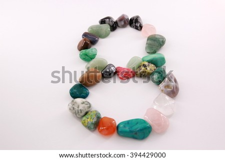 The number eight (8) made of color stones - stock photo
