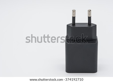 The old black phone charger