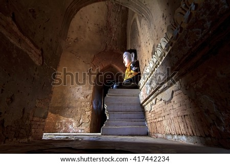 The old Buddha statue in old pagoda temple  at mandalay myanmar - stock photo