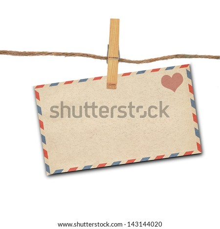 the old envelope and clothes peg white background - stock photo