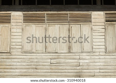 the old wood window texture on old building - vintage background - stock photo