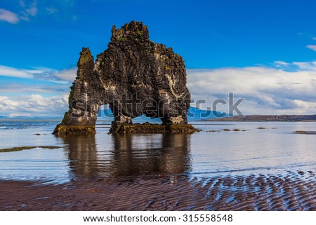 The picturesque cliff  in Iceland as huge prehistoric monster. Remains of an ancient extinct volcano Hvitserkur on the sea shelf - stock photo