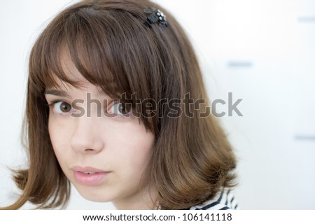 The portrait of the girl which is perplexed - stock photo