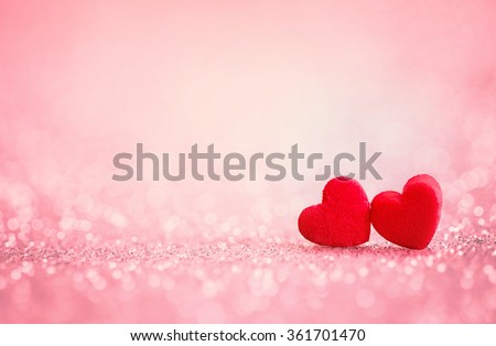 The red Heart shapes on abstract light glitter background in love concept for valentines day with sweet and romantic moment - stock photo