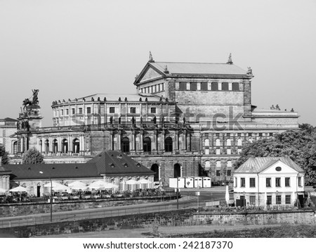 The Semperoper opera house of the Saxon State Orchestra aka Saechsische Staatsoper Dresden was designed by Gottfried Semper in 1841 in black and white - stock photo