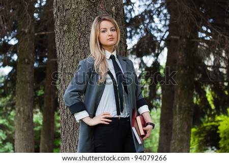 The serious blonde with books - stock photo