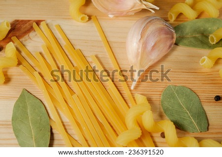 the set of products - pasta, spices, garlic closeup