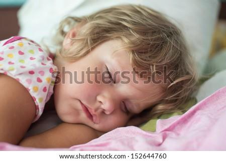 The sleeping child - stock photo