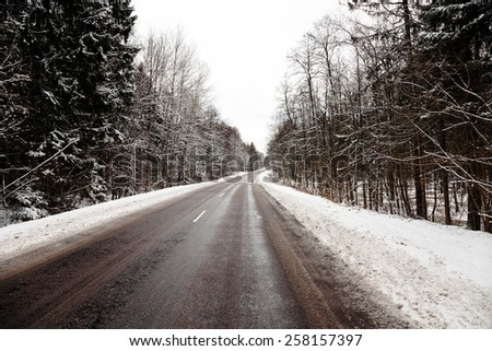 the small road photographed in a winter season