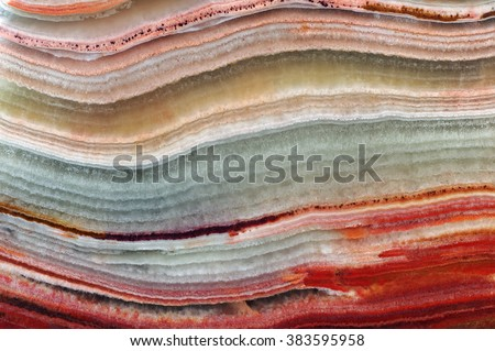 The structure (pattern) of the variegated onyx / texture of natural stone , onyx, marble, agate  - stock photo