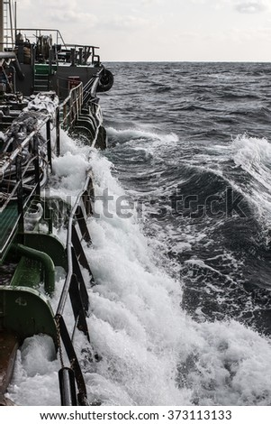 the tanker is sailing on a stormy sea