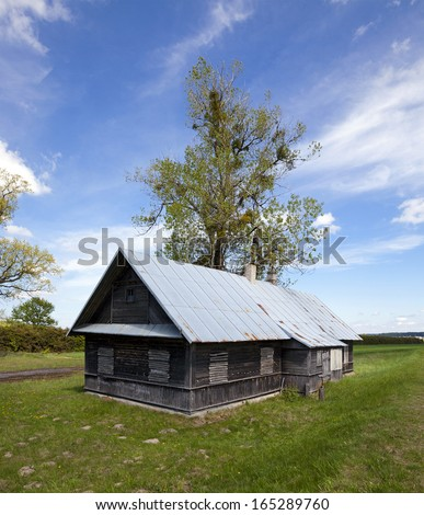 the thrown old wooden house located in rural areas