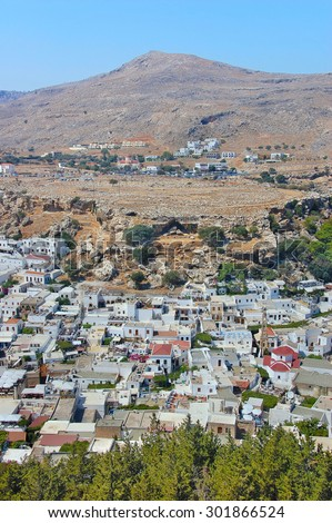The view from a height on a beautiful white stone town of Lindos.Rhodes island. Dodecanese. Greece. Europe