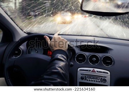 The winter weather on the way - falling snow - stock photo