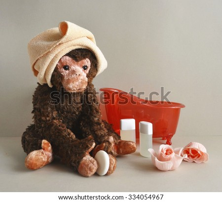 2016 - the year of the monkey.Toy monkey with bathroom accessories