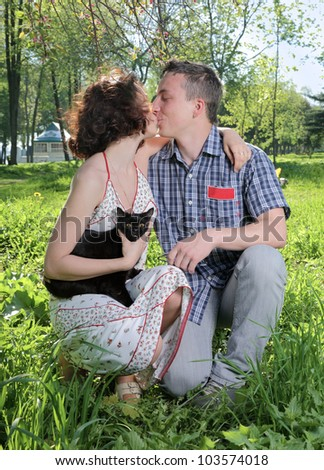 The young man and the girl kiss - stock photo