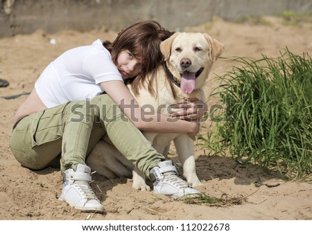 The young woman embraces a dog - stock photo