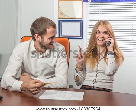 The young woman listens to good news by phone - stock photo