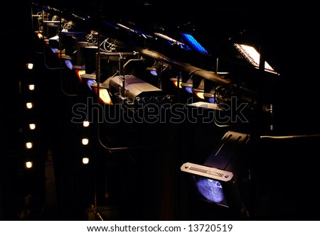 theatrical multicolored light equipment above a stage - stock photo