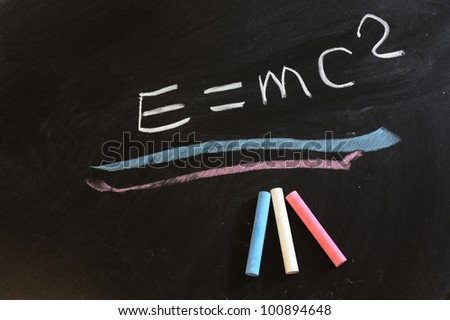 """Theory of relativity"" formula written on chalkboard - stock photo"