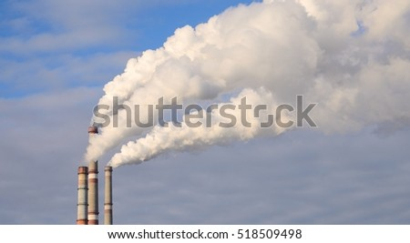 Thick smoke from factory chimneys. Pipe with smoke.  Heat energy network. CHP. Harmful emissions into the atmosphere. Air pollution and disruption of the Earth's ozone layer.