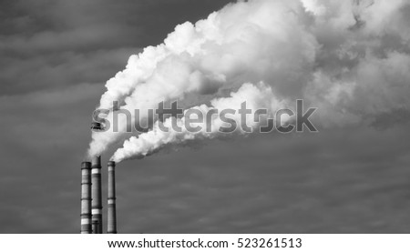 Thick smoke from factory chimneys. Pipe with smoke.  Heat energy network. Harmful emissions into the atmosphere. Air pollution and disruption of the Earth's ozone layer. Water pollution and nature.