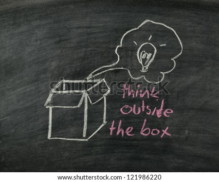 """think outside the box"" concept on blackboard - stock photo"