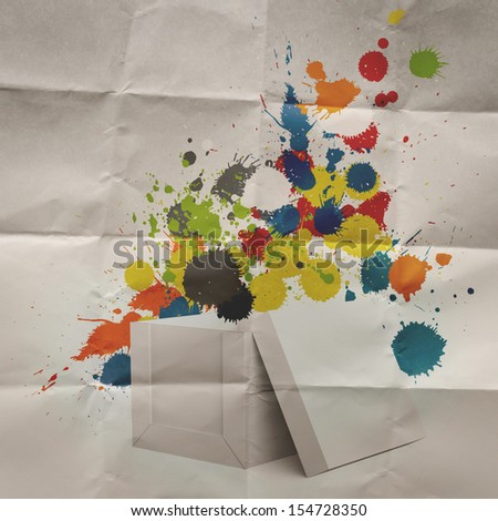 thinking outside the box and splash colors crumpled paper as concept - stock photo