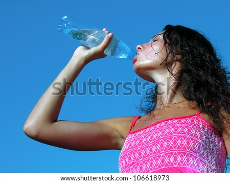 Thirst. Young woman drinking cold water in hot day