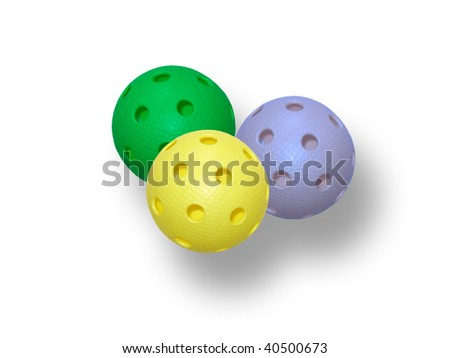 Three floorball ball isolated on a white background (yellow, blue and green) - stock photo