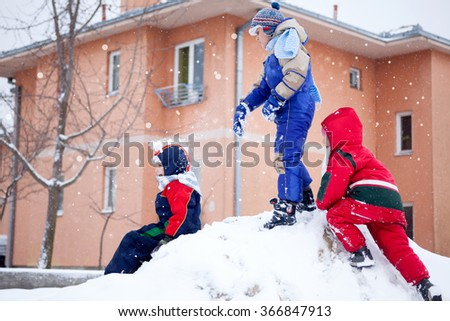 three happy kids outdoor playing,winter time