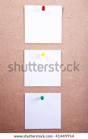 three sheets of paper attached by  thumbtacks