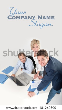 Three smiling business people looking at the camera