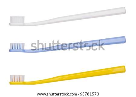 Three tooth - brush, on egg white background. - stock photo