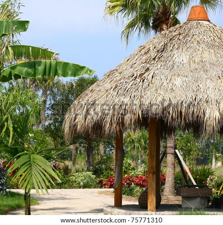 Tiki Hut With Thatched Roof U0026 Tropical Landscaping.