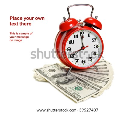 """Time is money"" concept - classic alarm clock over dollars"