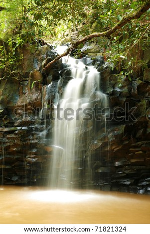 """time laps"" aka ""long exposure"" of about 15-30 seconds of a beautiful water fall on the hawaiian island of maui - stock photo"