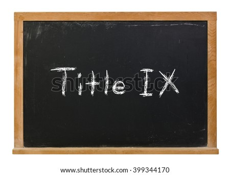 Title IX 9 written in white chalk on a black chalkboard isolated on white