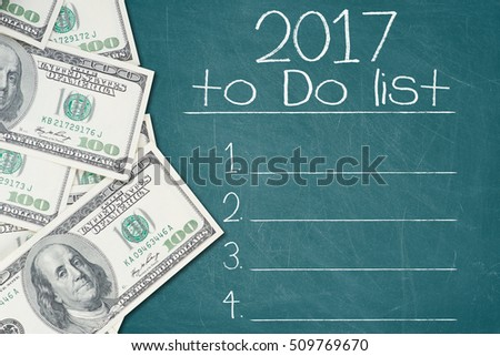 2017 TO DO LIST text written on a green chalkboard with a number of one hundred US dollar notes