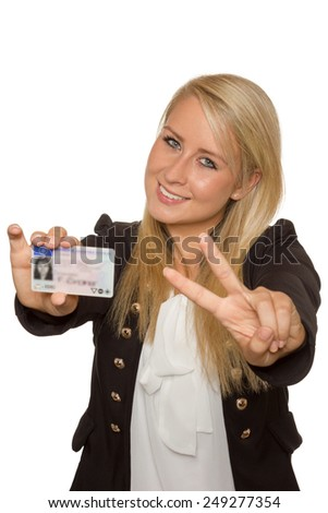 16 to 18 year old girl just received her driver license - stock photo