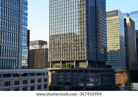TOKYO/JAPAN - OCTOBER 17, 2014: Buildings in Marunouchi business district and Tokyo Station since the roof of the mall Kitte