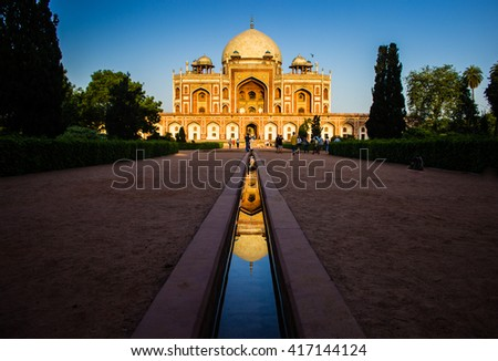 Tomb of King Humayun in Delhi, India shines in the golden light around sunset. Mughal architecture at its best. Great architecture and Mughal style - stock photo
