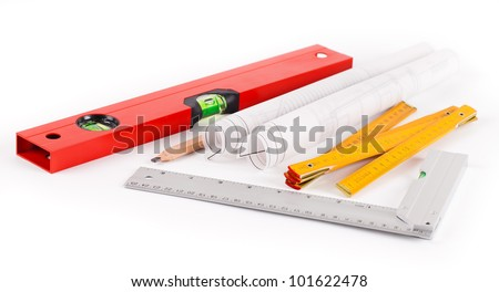 tools and construction plans on white background - stock photo