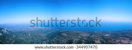 top of mountain overhanging sea panorama - stock photo