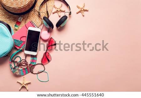 Top view of essential modern young lady or girl on vacations.Woman's summer holidays accessories composed on pastel color background. Beach fashion , summer concept. Trendy colors. - stock photo