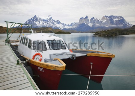 TORRES DEL PAINE, CHILE - APRIL 7, 2015: Boat at Lake Pehoe in National Park Torres del Paine, Patagonia, Chile