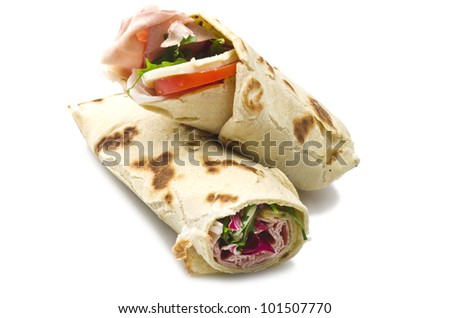 tortilla wraps with ham,cheese,and vegetables - stock photo
